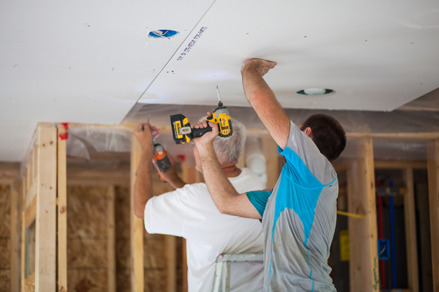installing ceiling drywall in accessible home